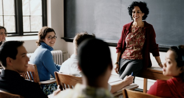 female professor talking with students.