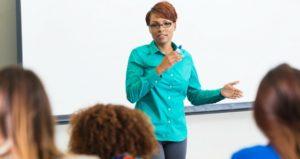 female professor in front of white board