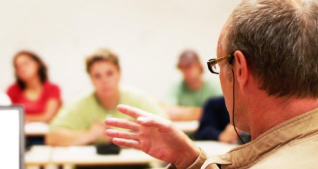 Teacher explains concept to class.