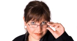 female professor looking over glasses