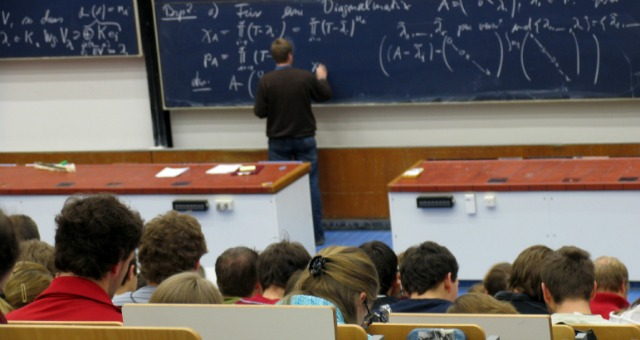 professor writing on board