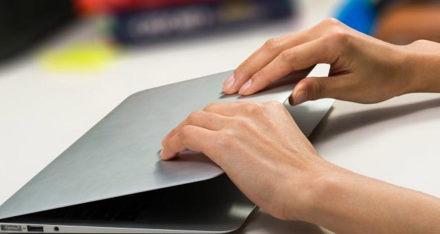 woman closing her laptop
