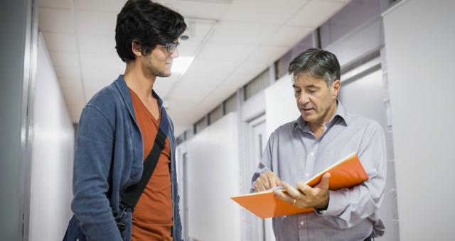 Professor and student discuss grade.