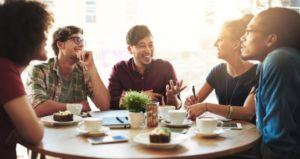 Students gather at coffee shop to discuss course