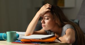 Student puts hand on head in despair of turning in late homework