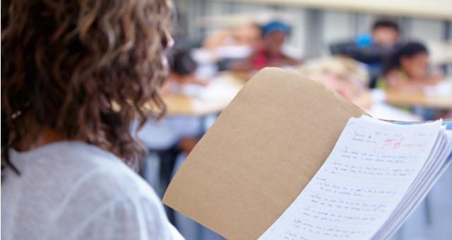Teacher assesses grading on paper