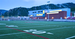College football field with spotlight reflects parable in article