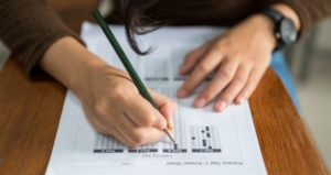 Student takes test assessment in class