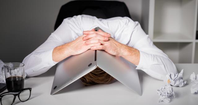 Instructor hides under computer