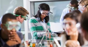 College students experiment with test tubes in the science lab