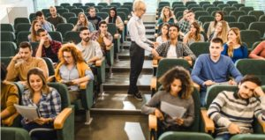 Professor has open discussion about topic in large lecture hall