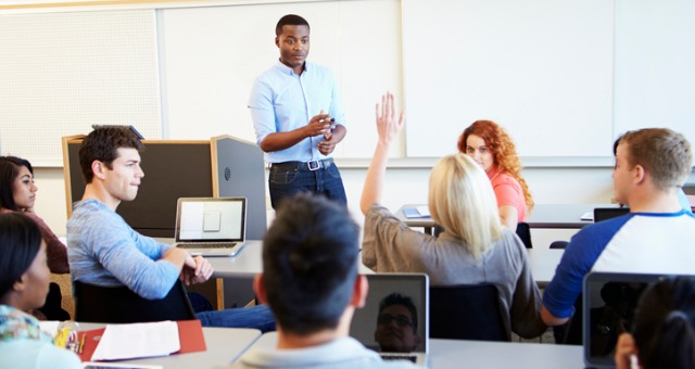 Teacher directs classroom discussion with engaged students