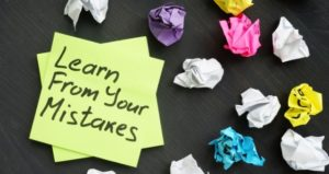 Crumpled sticky notes reflect learning from your mistakes