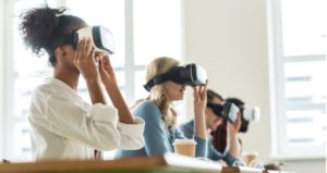 Students wear virtual reality technology in college classroom