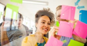 Students gather for starter activity by placing sticky notes in front of class