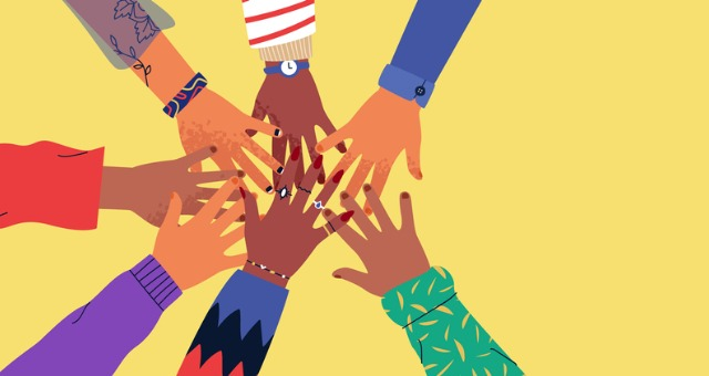 Hands come together from all different backgrounds