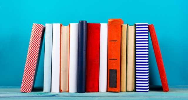 Group of colorful books sits on table