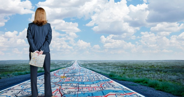 Woman stands on roadmap overlooking road