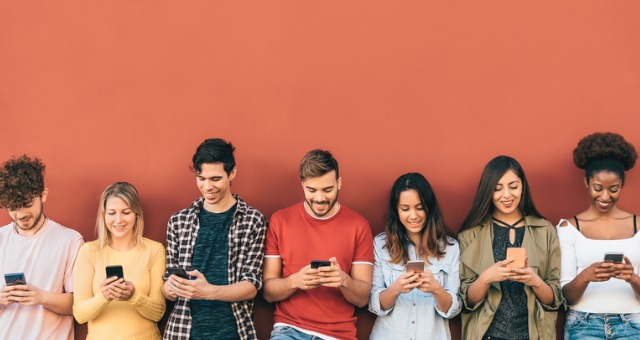 Group of students all using their smartphones