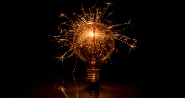 Lightbulb creates spark and ominous glow