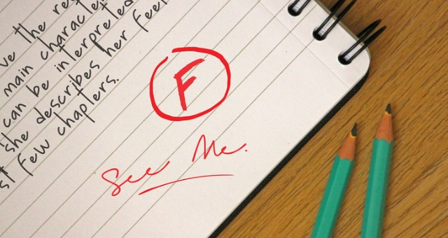"""Student paper has the grade """"F"""" written on it and a """"See me"""" note"""