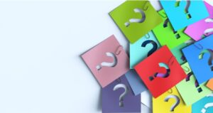 Sticky notes of question marks on different colored paper