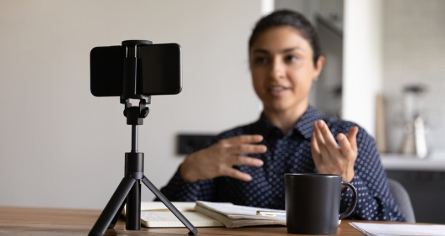 Teacher records herself with video recording device for asynchronous instruction