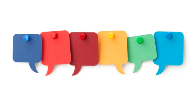 Six colorful sticky notes in the shape of talking blurbs