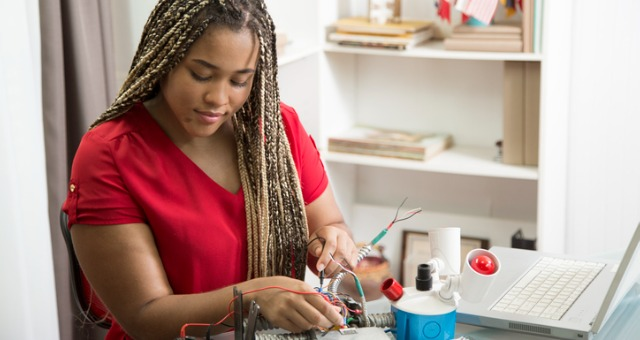 Student works on STEM project with at-home science kit