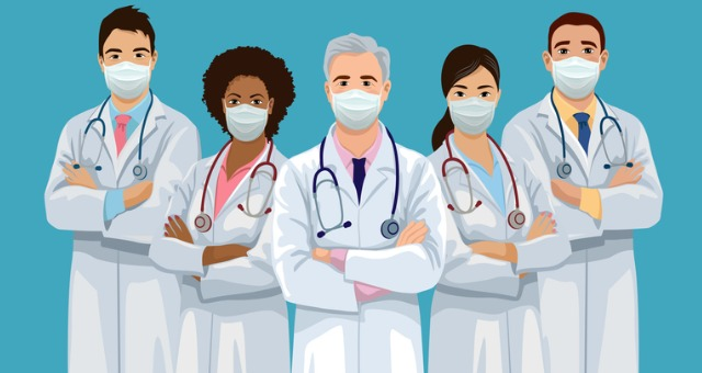 Team of doctors stand together with masks