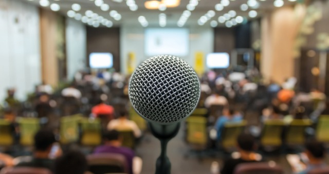Microphone on stage in front of audience
