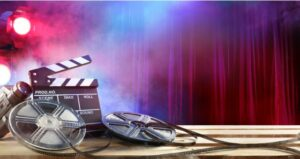Lights, camera, action movie materials lay in front of curtain