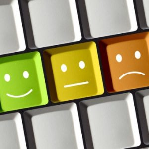 Computer keys have faces ranging from green smileys to red frown