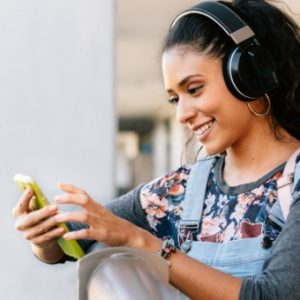 Student looks at phone in her free time