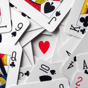 Deck of cards sprawled out on table