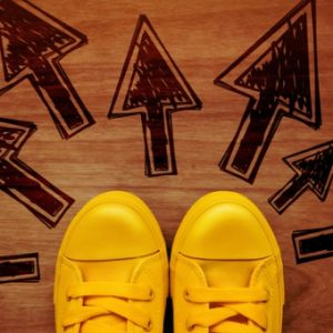 Shoes with arrows in front of them indicate transition