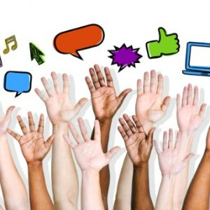 People's hands are raised with online icons displayed on top of their hands